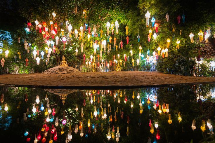Gold buddha image under lantern tree and reflection of pond by Chan Punya - Photo 82116847 - 500px