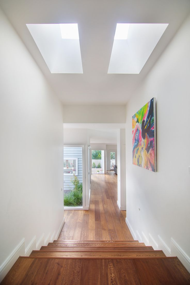 Large hallway with skylights above and view to courtyard for Large skylights