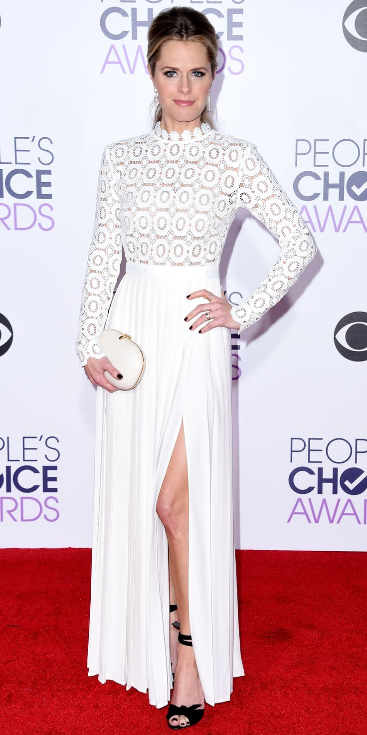 Maggie Lawson in a white dress, Jeffrey Levinson clutch, Alexandre Birman shoes, and Randall Scott Fine Jewelry.