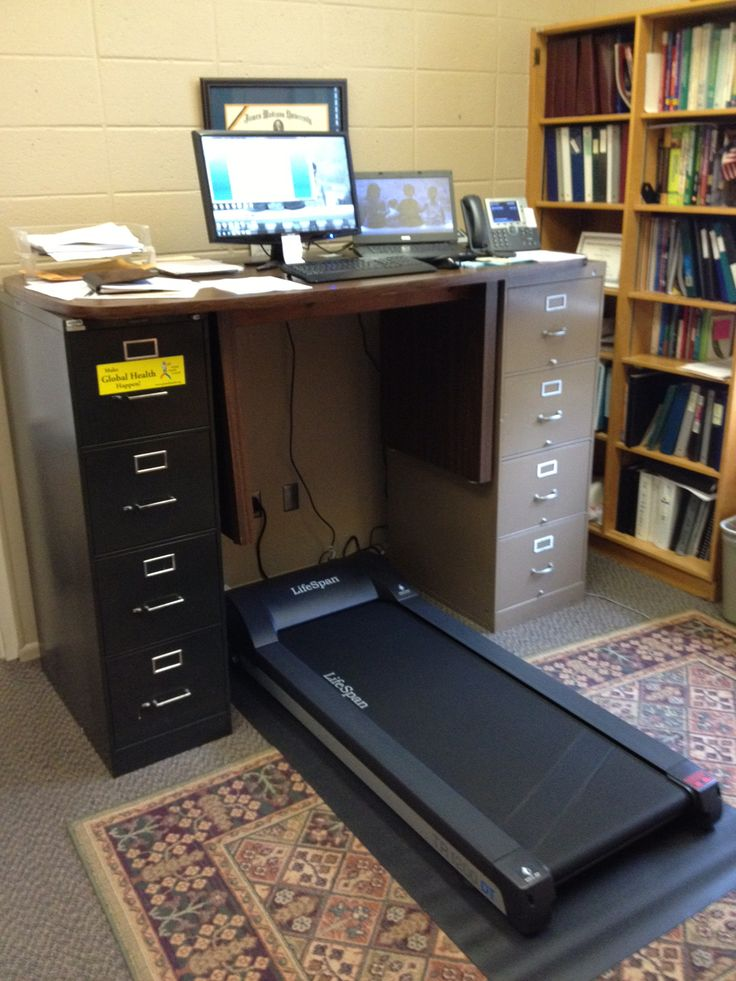 The Jung 2000 - a standard desk placed on top of two filing cabinets to make room for treadmill.