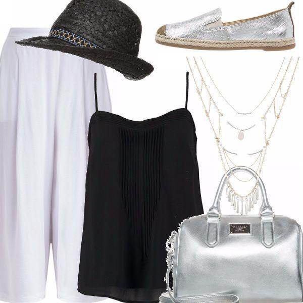 Outfit basato sul black and white, un accostamento di colori che non passa mai di moda; con l'aggiunta di accessori color argento che illuminano il look Outfit di tendenza, con capi stilosi e semplici che tuttavia danno vita a un look di effetto.