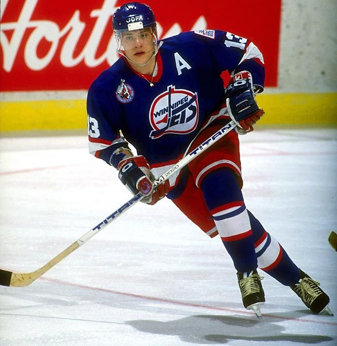 "Former Winnipeg Jets #13 Teemu Selanne, ""The Finnish Flash"". Set an NHL rookie record during the 1992-93 NHL season with 76 goals."