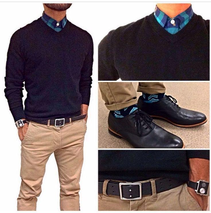 Blue aqua plaid button shirt, dark v-neck sweater, tan slacks, and dark dress shoes