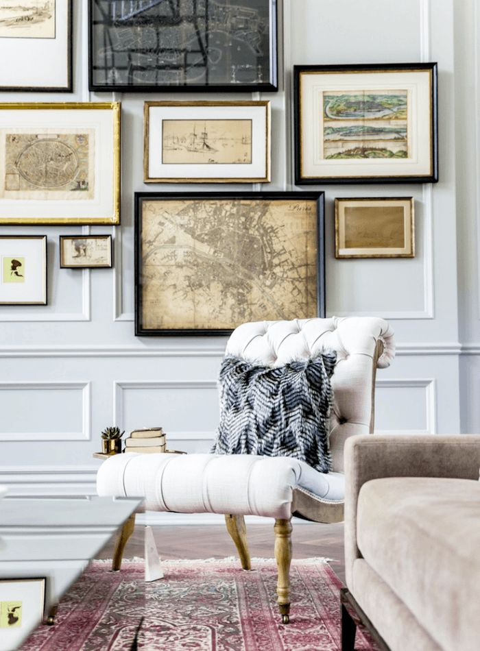 Rue Magazine | Interior Design-Tonya Olsen-Photography-Lindsay Salazar - fabulous art gallery wall in a family room, den or home office with a slipper chair and an oriental rug. Love the panel moulding and the pale gray walls