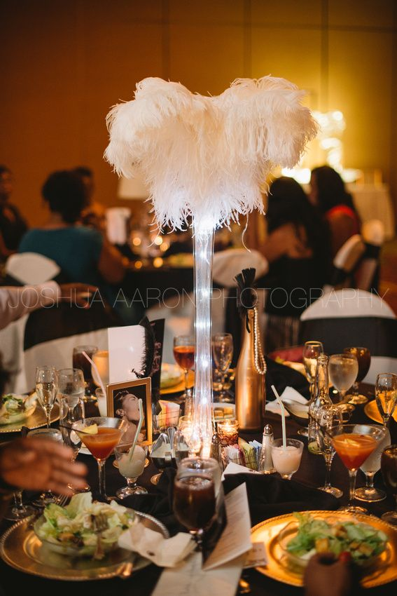 Ostrich feather centerpieces at Harlem Renaissance wedding...Wishes Granted Events.