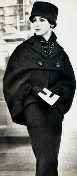 Dior 1953. Love how in that time, elegance and sexy are one in the same with only showing the face!