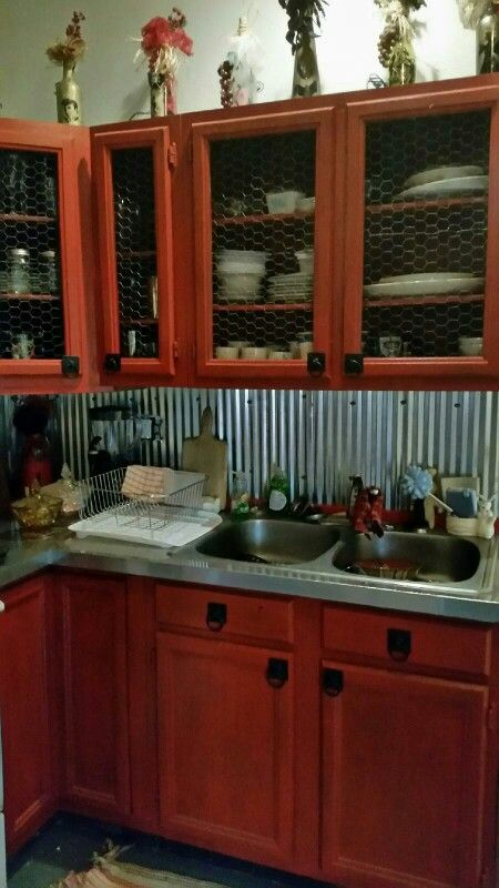 My rustic log cabin chicken wire cabinets with stainless steel countertops  and corrugated steel back splash