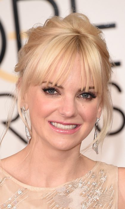 Anna Faris It can be hard to pull off bangs on a red carpet, but the 38-year-old mom aced the look by pairing hers with a loose ponytail and glam drop earrings. Photo: © Getty Images