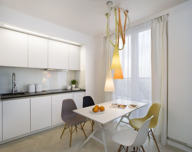 Apartment: Minimalist Krakow Apartment Designed by Morpho Studio, Krakow Apartment with White Open Floor Kitchen and Small Dining Room Featruing Unique Pendant Light and Multicolored Chairs Designed by Morpho Studio