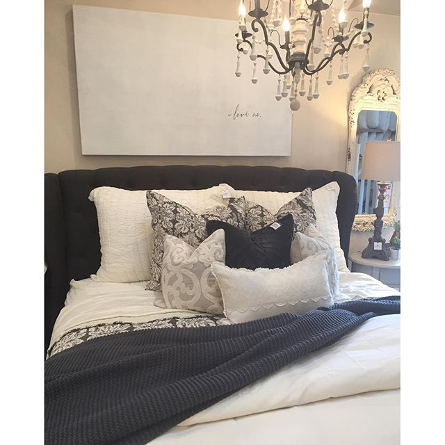 We're a little obsessed with everything. The bedding, the light, the simple art…