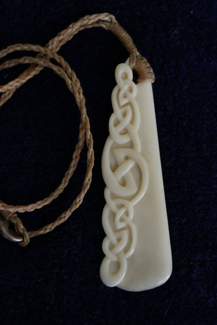 hand carved bovine bone, unique design incorporating the Maori Hei Matau (fishhook) and embedded Celtic/tribal design. Strung with waxed hemp cord hand plaited. For sale at www.batty4ar...