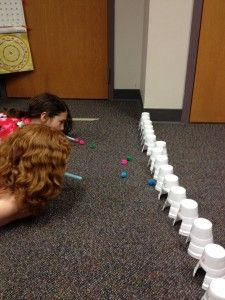Blow cotton balls with straws into cups with letters.  Visit…
