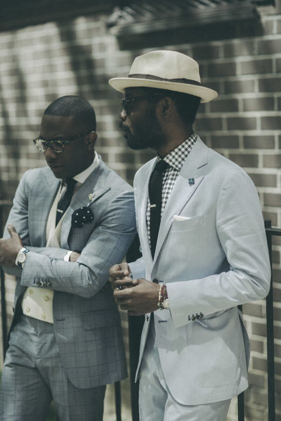 Tap into refined, elegant style with a baby blue suit and a white and black gingham oxford shirt. Shop this look on Lookastic: https://lookastic.com/men/looks/suit-dress-shirt-hat/16628 — Beige Wool Hat — White and Black Gingham Dress Shirt — Black Knit Tie — White Pocket Square — Light Blue Suit