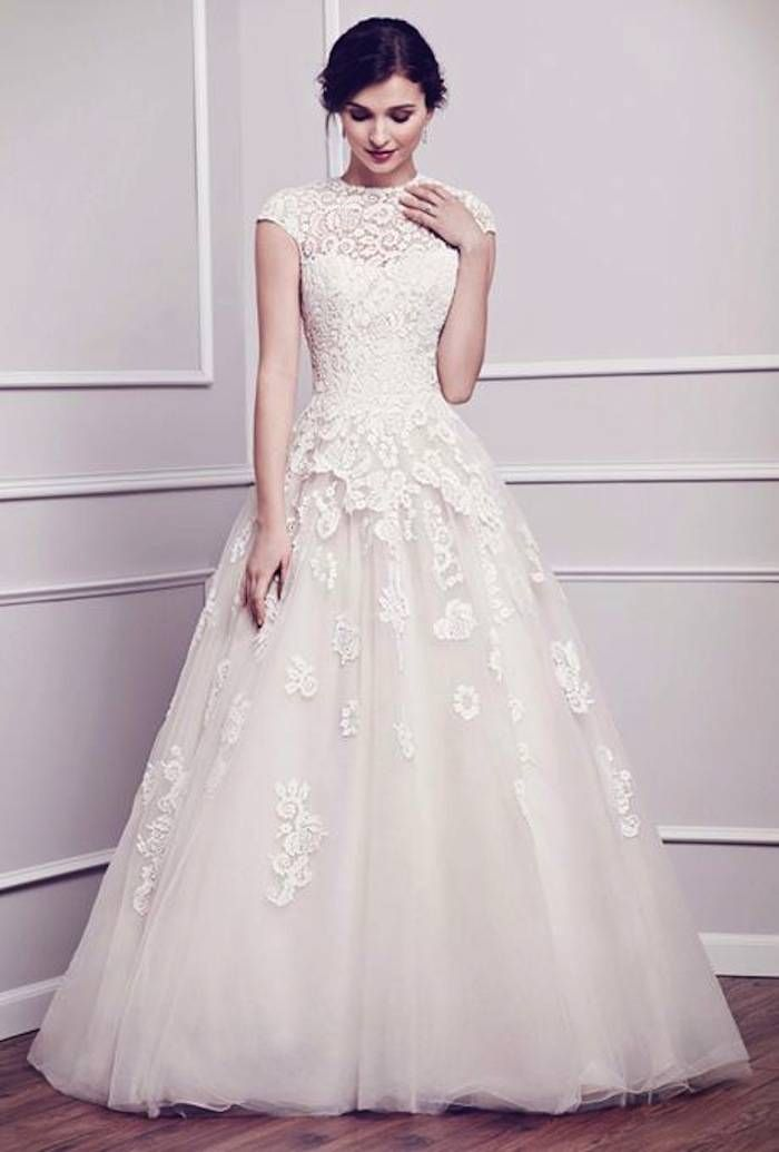 A classic ball gown with beautiful lace details and capped sleeves. Dress by Kenneth Winston