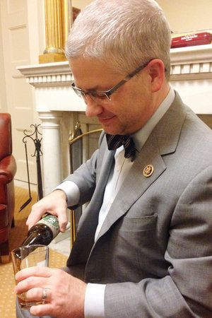 """""""Brewers in my district are about not only about the sort of art of brewing, they're about jobs,"""" says Rep. Patrick McHenry, seen pouring a beer in his Capitol Hill office."""
