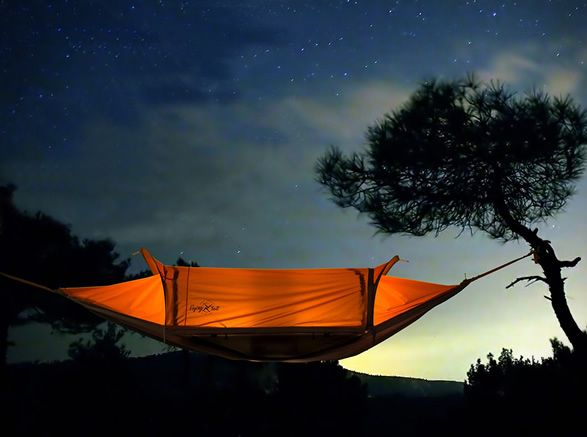 The awesome Flying Tent is a clever four-in-one concept, which allows you to combine maximum functionality and minimal carry. It is an all-weather hammock that doubles as a bivy tent, can be worn as a rain poncho and then folds into a backpack! The v