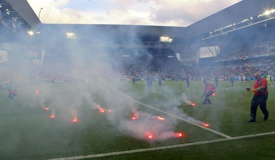 And #France claims it has good security?! Just hollow words from France for the #EURO2016 !! #Flares are thrown onto the pitch during the Euro 2016 Group D soccer match between the Czech Republic and Croatia at the Geoffroy Guichard stadium in Saint-Etienne, France, Friday, June 17, 2016. Czech Republic salvaged a 2-2 draw with Croatia in a game marred by a temporary suspension when flares were thrown onto the pitch and Croatia fans fought among themselves.