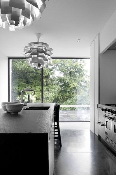 Beautiful kitchen with Louis Poulsen 'Artichoke' Design by Poul Henningsen lights | Daskal-Laperre