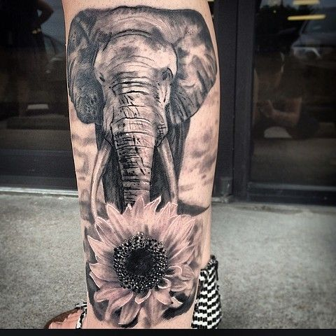 Black And Grey Elephant And Sun Flower Realistic Tattoo On Side Leg
