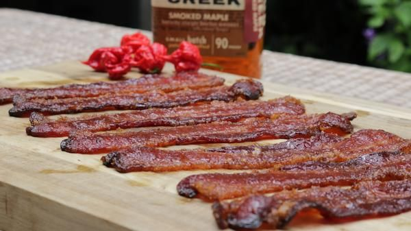 Today, we're making Maple Bourbon Pig Candy. Pig Candy is bacon cooked on the grill or a smoker with some sweetnes...and we all know bacon makes everything better! To spice up this Pig Candy, we will add a little of the world's hottest p...