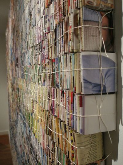 Amanda Nelson -- 8 by 5 foot wall hanging is comprised of approximately 40,000 pieces of junk mail, folded and string-bundled into 2 inch cubes to create colored pixels. 2009