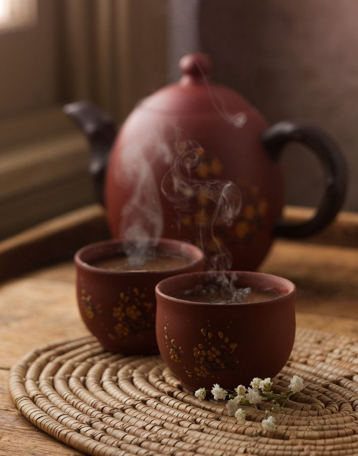Terracotta teapot and cups, a material commonly found in ancient Chinese pottery and sculpture.