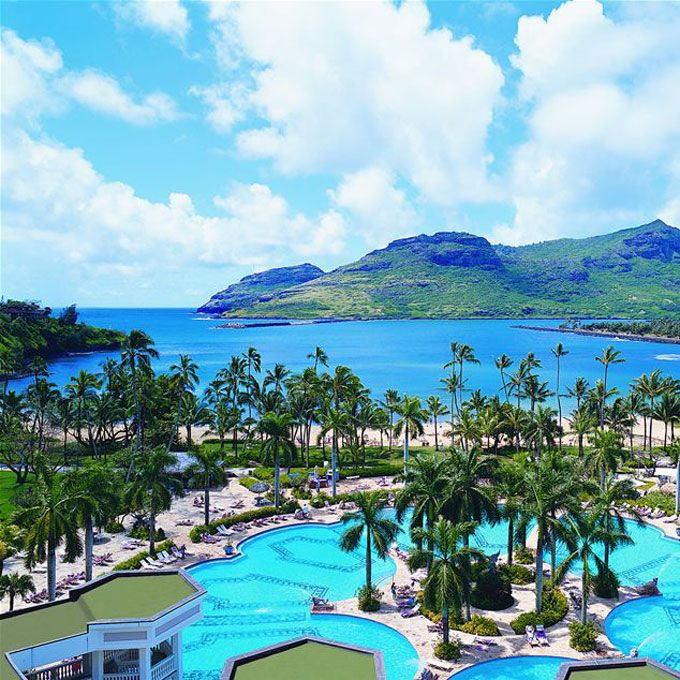 Brides.com: . 20. Kauai Marriott Resort. This gorgeous hotel offers pretty much everything—Hawaii's biggest pool, five open-air restaurants, a great bikini shop—on 800 acres fronting Kalapaki Bay—a local hangout on the weekends for volleyball, surfing, and just plain old sunbathing. Bonus: Everything looks spiffy after a $50 million makeover.   Rooms from $413; Kauai Marriott Resort