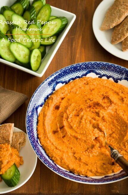 Bright orange with a smoky, creamy taste, roasted red pepper hummus goes together in minutes with a food processor. Serve with cool cucumber slices