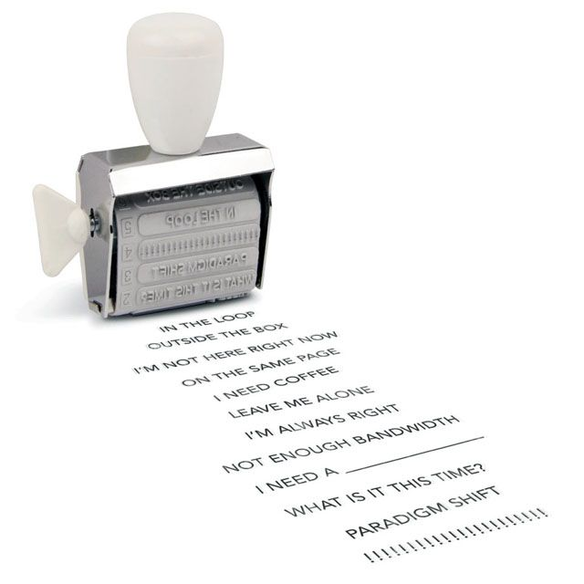 "Fancy - Office Speak Rotating Stamp Put the right words right where you need them: on a convenient rotating stamp!  With twelve eminently inkable phrases (plus black ink pad), this handy gadget does the talking (and back-talking) for you.  You're sure to be a pro at being professional in no time, even if your ""desk"" is at the library or coffee shop. Includes a hint of wit and a ton of functionality"