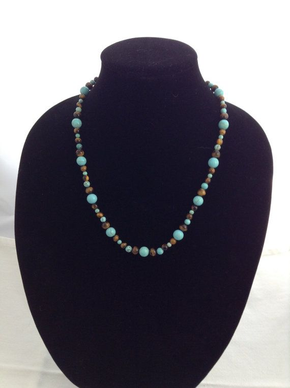 Tiger's Eye and Turquoise Howlite make this 22 inch Necklace a Favourite Any…