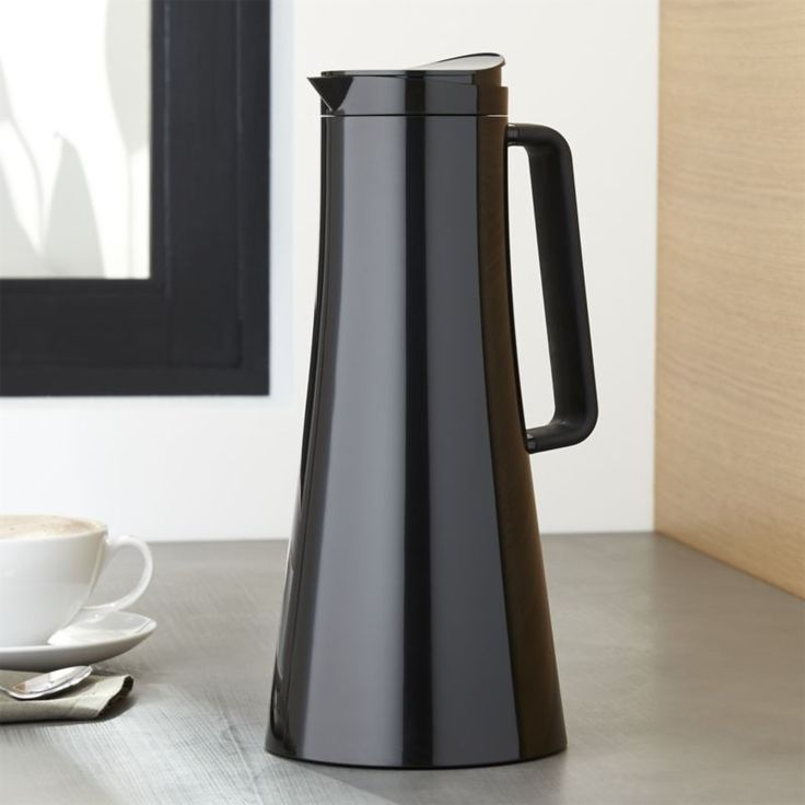 With its sleek and shapely design in stylish black, this generous, contemporary vacuum carafe retains hot or cold temperatures for an extended period, conserving energy while keeping your favorite beverage right at hand. A quick press of the lids lets fluids flow, snaps closed to keep temperature control.View all Bodum products