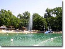 Ft Worth's Burger's Lake is a 30-acre park featuring a one-acre spring-fed lake for swimming.  includes:  - Two sandy beaches for sunning; wonderful big trees for shade  - A complete staff of certified lifeguards  - Over 300 picnic tables  - Six diving boards, a 20-foot slide and 25-foot trapeze  - Charcoal grills for cooking  - Plus much, much more!!!