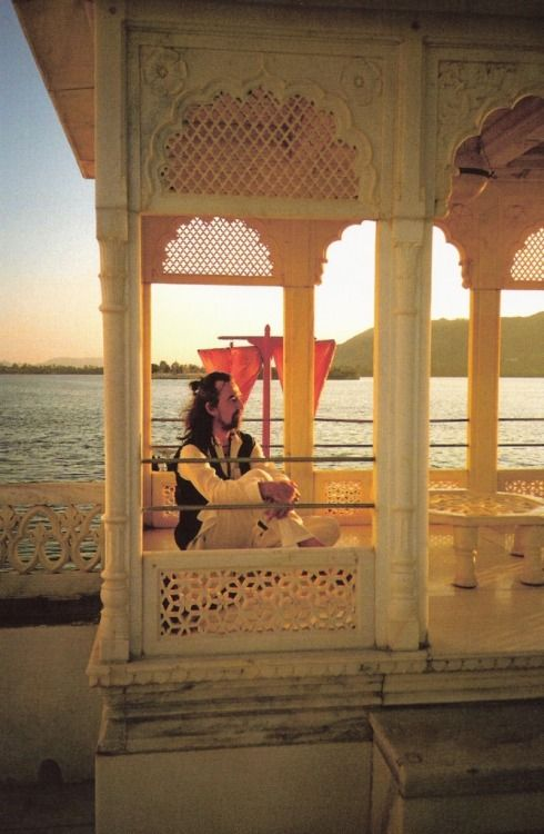 "George Harrison - Lake Pichola, Udaipur, India, 1994. Photo: Olivia Harrison. ""It's in India - it's him looking out to another world, really. And that it's India and maybe reflects his inner journey."" - Olivia Harrison on why she chose this as the final image in the book Living in the Material World, WNYC interview, November 4, 2011"