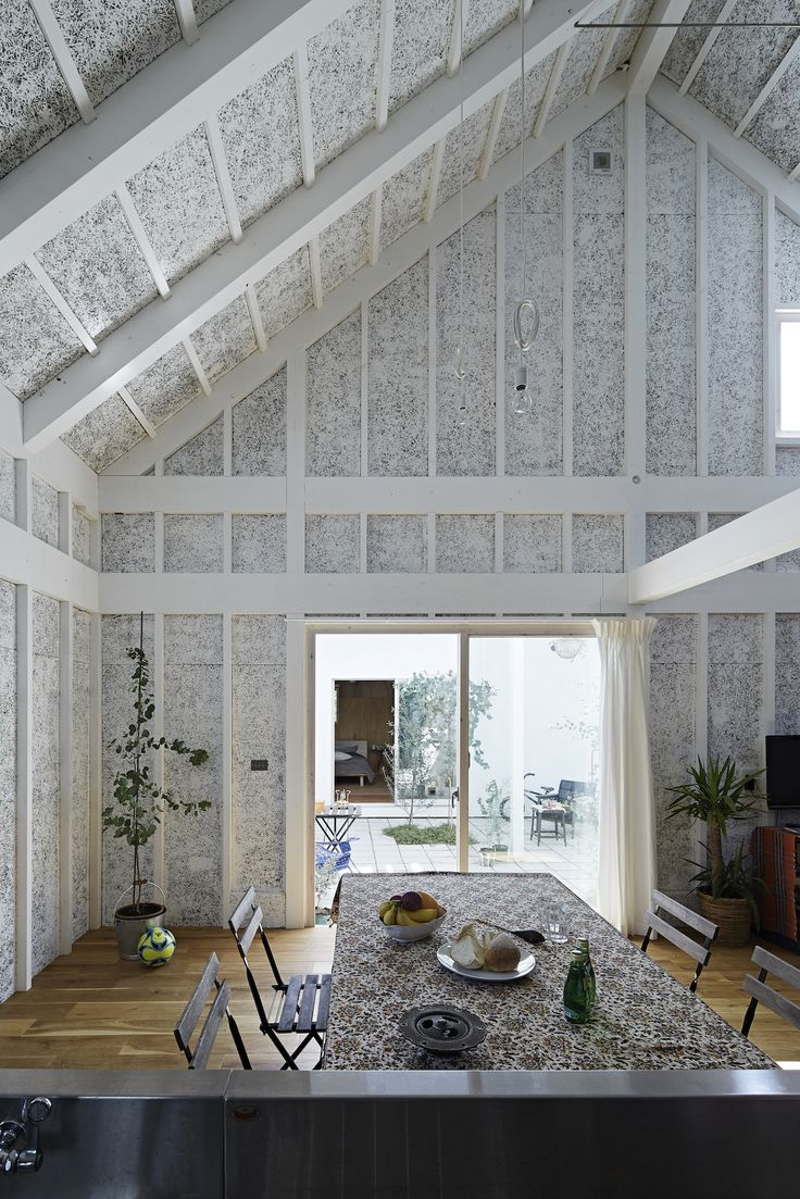 Sabi, a surfers' house in Chiba, Japan, designed by No. 555 architects. The textured walls are painted wood-wool blocks, a combination of recycled wood fiber and cement typically hidden behind sheetrock and used as insulation.