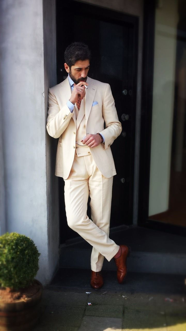 A fabulous soft beige summer three piece suit.