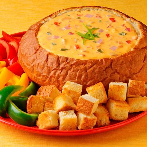 Hawaiian Queso Dip: A cheesy dip recipe served in a sweet bread bowl with its sweet and smoky flavor coming from crushed pineapple and ham.    Velveeta® and Oscar Mayer® are registered trademarks of Kraft Foods, Inc. Ro*Tel® is a registered trademark of ConAgra Foods RDM, Inc.