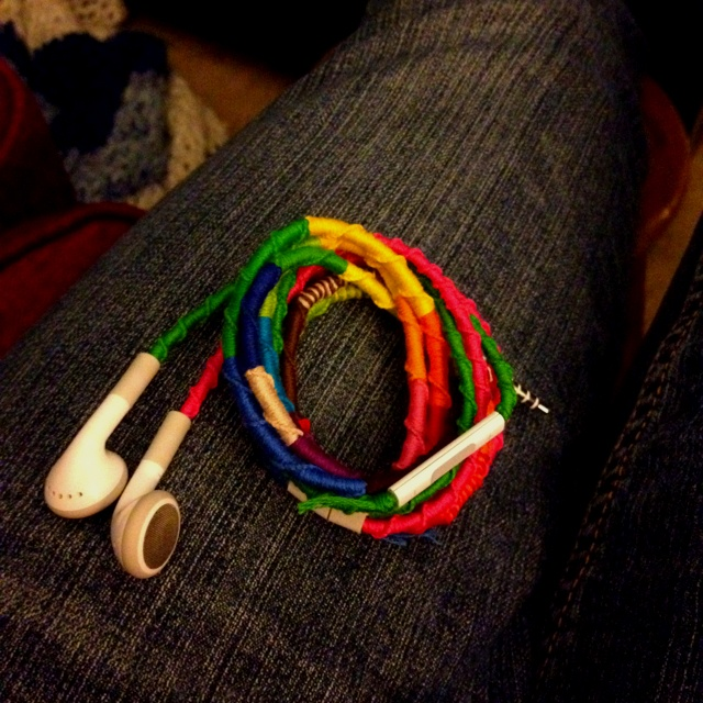 Ear buds wrapped like friendship bracelets with Chinese stairs knots.