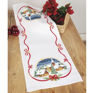 "Snow Village Table Runner  YOUR YULETIDE SPIRIT shows with our charming snow village table runner. Counted cross stitch kit includes 11-count white Aida cloth, presorted DMC cotton floss, needle, chart and directions. 12 3/4"" x 33 1/2"". Imported from Belgium. A Stitchery exclusive!	      ****   Snow Village Table Runner  Item #: T25335  Price: $59.99"