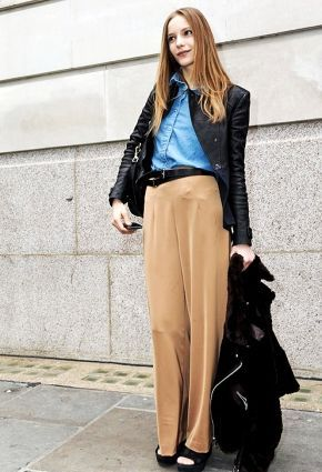 Blue shirt paired with beige trousers and black jacket.