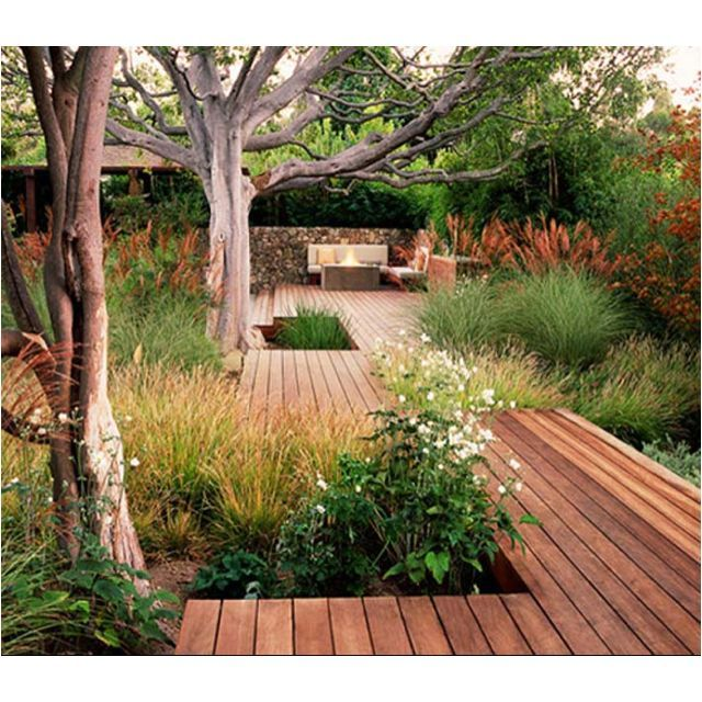 Like the native garden with the decking also the nice for Garden design decking areas