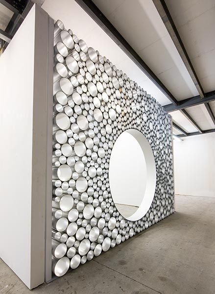 Could do something like this out of the plastic tubes we just got!   installation art made with pipes to make a big separating wall.