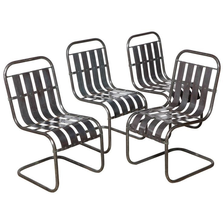 set of four industrial steel spring side chairs circa 1930