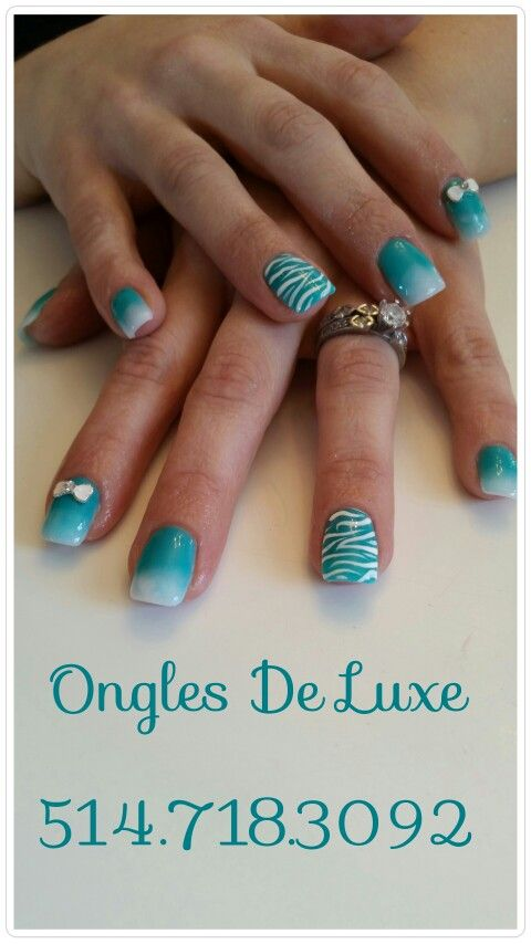 Turquoise and white ombre nails with zebra print and white bows
