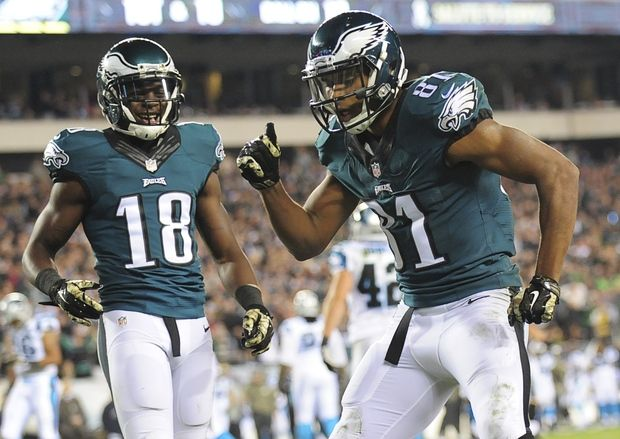 Jordan Matthews #81 and Jeremy Maclin #18 of the Philadelphia Eagles react after Matthews scored a touchdown against the Carolina Panthers on November 10, 2014 at Lincoln Financial Field in Philadelphia, Pennsylvania.