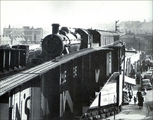 Steam train approaching barnsley court house railway station