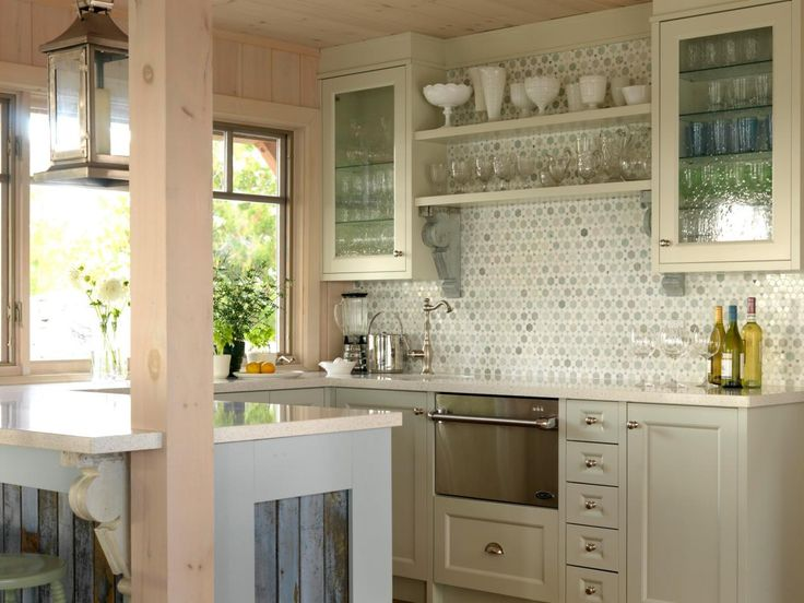 Kitchen with glass face cabinets