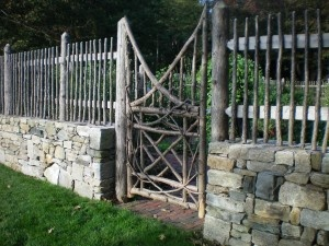 Love the combo stone wall and rustic fence!