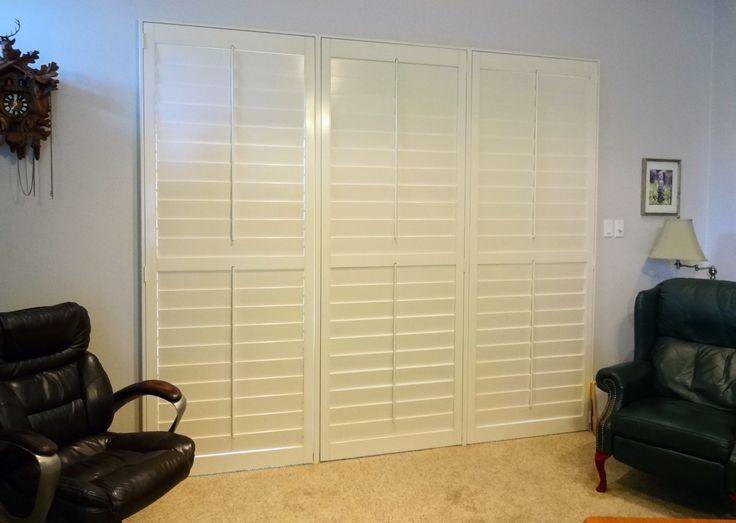 shutters on a sliding glass door make it look like a window