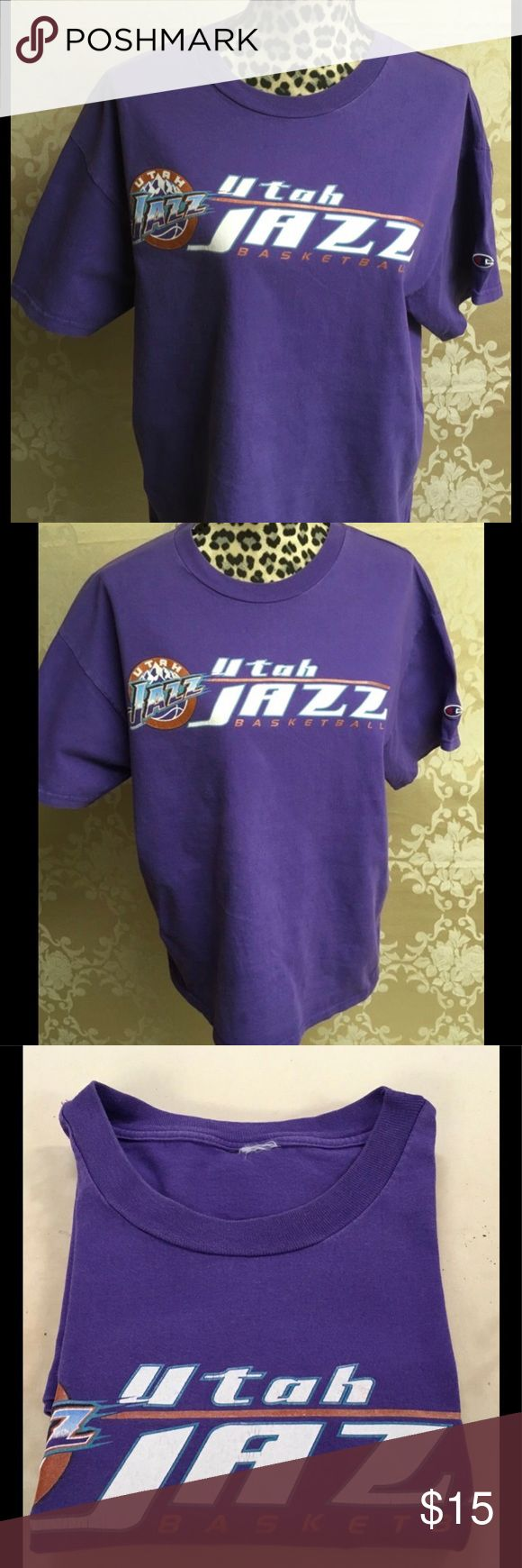 UTAH JAZZ TEE. Love this era of the Utah Jazz when their colors were purple and teal. Wish they'd go back to that. It was the Stockton/Malone play-off era when their great demise was Michael Jordan. Tag is missing but I'm sure it's an XL. There's some signs of wear and tear and lots of love but nothing major. *Note - I have it in my 14/16 section of wardrobe. NBA Tops