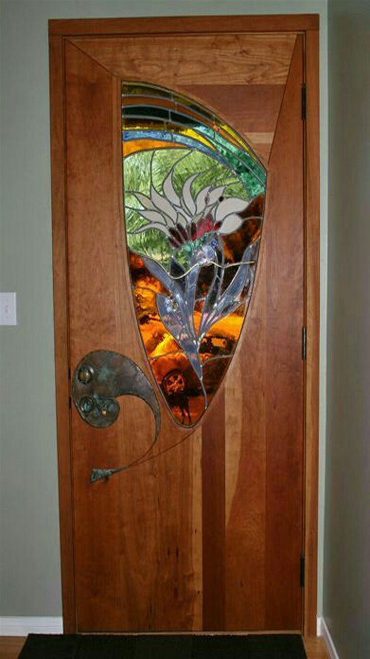 Stained glass door. - created  by James Hubbell